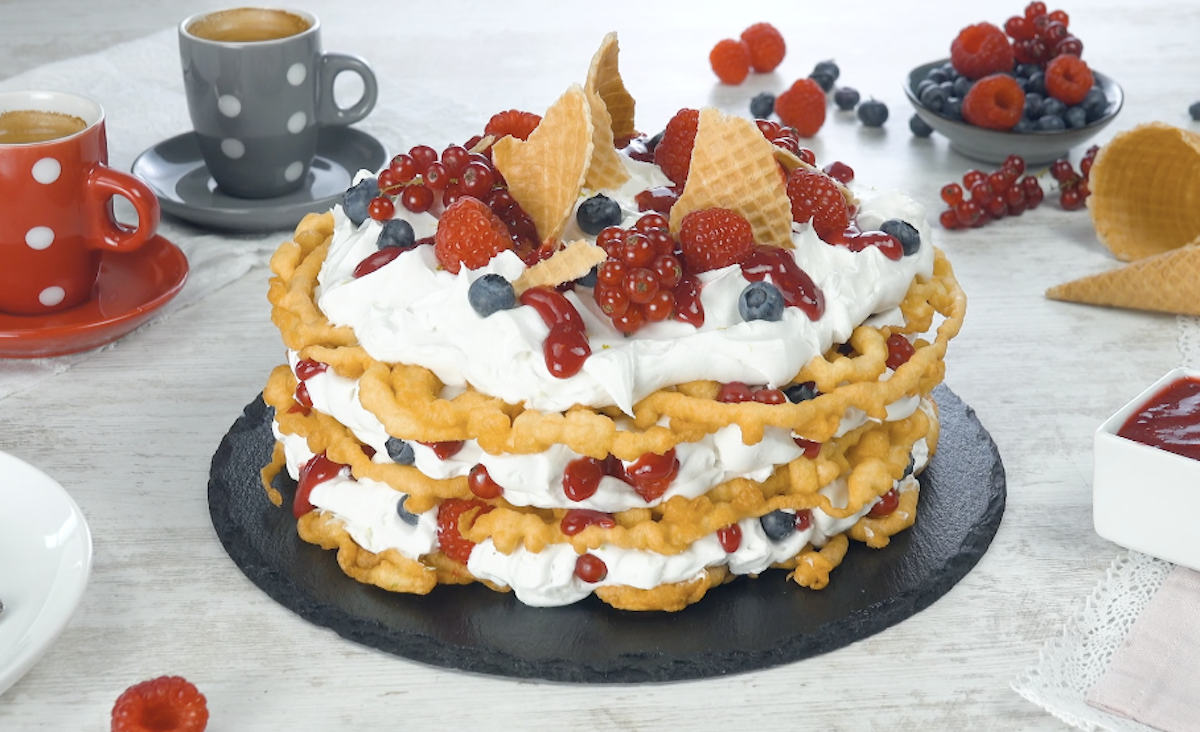 Homemade Funnel Cakes Covered With Coconut Cream And Fresh Berries