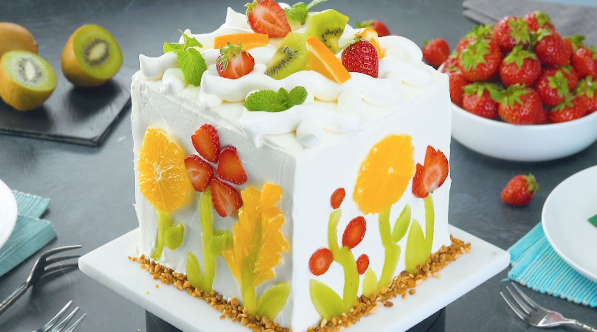 Beautiful Fruit-Filled Layer Cake With White Chocolate Frosting